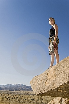 Climber Standing On Rock Looking At Desert Royalty Free Stock Images - Image: 13585249