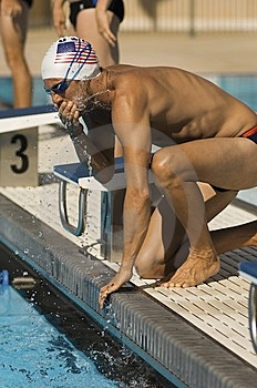 Swimmer Warming Up At Starting Blocks Royalty Free Stock Photo - Image: 13585345
