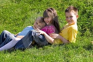 Family on a meadow Royalty Free Stock Photos