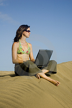 Surfergirl On Laptop2 Stock Photography - Image: 1364922