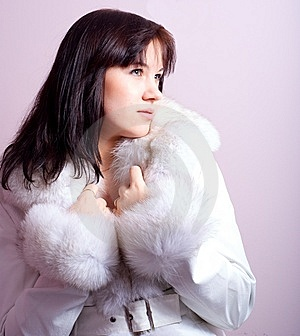 Cute Girl With A Furry Coat Royalty Free Stock Photos - Image: 13603378