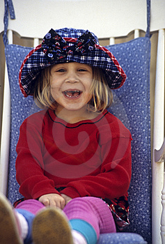 Cute Little Girl Sitting In Chair Royalty Free Stock Images - Image: 13605399