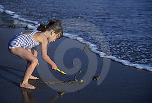 Little Girl Shoveling Sand On Stock Photos - Image: 13605473