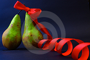 Two Pears One In A Red Gift Tape Stock Image - Image: 13616551