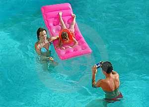 Family In Pool Take Pictures Royalty Free Stock Photography - Image: 13622707