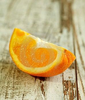 Part Of Orange On Wooden Royalty Free Stock Image - Image: 13622846