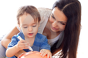 Mother And Son Drawing Picture On Balloon Stock Photo - Image: 13625390