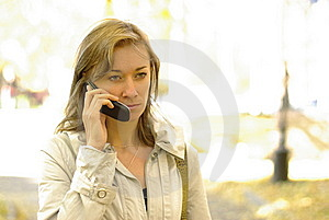 Female Calling By Phone Royalty Free Stock Photography - Image: 13627527