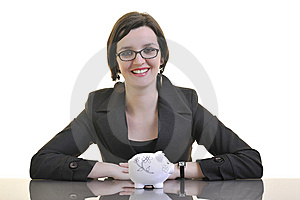 Business Woman Putting Money Coins In Piggy Bank Stock Photos - Image: 13632593