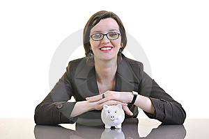 Business Woman Putting Money Coins In Piggy Bank Royalty Free Stock Photos - Image: 13632658