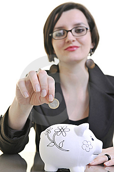 Business Woman Putting Money Coins In Piggy Bank Stock Images - Image: 13632784