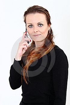 The Attractive Woman Talks By A Mobile Phone Stock Image - Image: 13639081