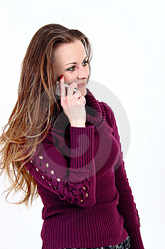 The Attractive Woman Talks By A Mobile Phone Stock Photo - Image: 13639120