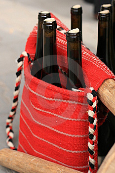 Wine Bottles In Traditional Woven Handbag Stock Images - Image: 13642754