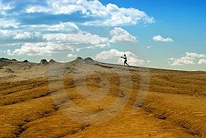 Photographer On Arid Landscape Stock Photography - Image: 13645852