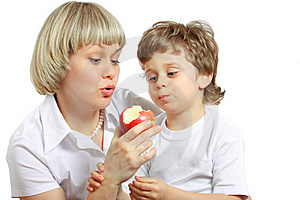 Woman And Boy Eating Apple Stock Photos - Image: 13661743