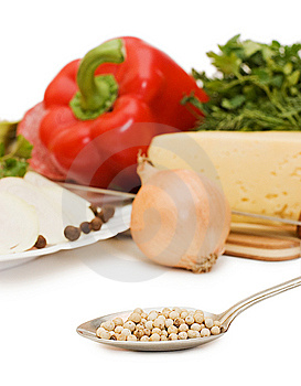 Spices On A Spoon Against Vegetables Stock Images - Image: 13665844
