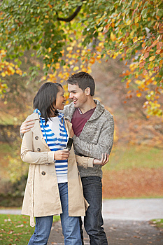 Romantic Teenage Couple In Autumn Park Stock Images - Image: 13671834