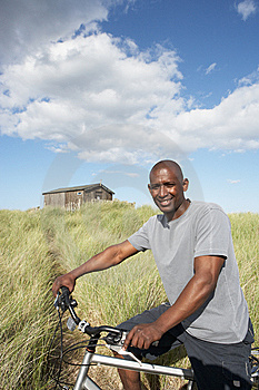 Man Riding Mountain Bike By Dunes Royalty Free Stock Photo - Image: 13673095