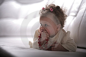Baby Girl With Red Beads In Profile Stock Images - Image: 13680554