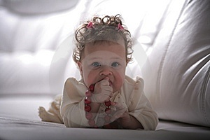 Baby Girl With Red Beads Royalty Free Stock Photo - Image: 13680565