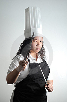 Asian Chef Preparing To Fight With Knifes Stock Image - Image: 13683171