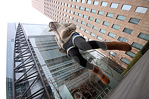 Young Japanese Girl Jumping In Front Of Buildings Stock Photography - Image: 13684572