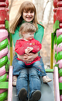 Mother And Daughter Sitting At The Top Of A Slide Royalty Free Stock Images - Image: 13691209