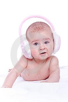 Happy Baby With Pink Fur Headphones Stock Photo - Image: 13696380