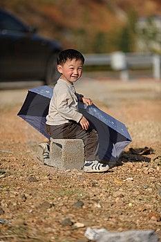 Asian Boy And Umbrella Stock Photo - Image: 13698280