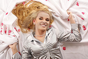 Attractive Blond Lying On A White Blanket Royalty Free Stock Photography - Image: 13698467