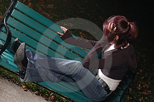 Crying girl on a park bench 3 Royalty Free Stock Photo