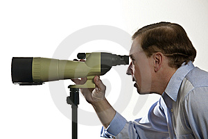 Man Looking Through Spotting Scope Royalty Free Stock Image - Image: 13704036