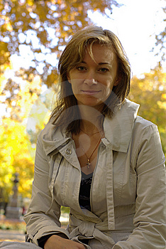 Woman In An Autumn Park Royalty Free Stock Image - Image: 13706456