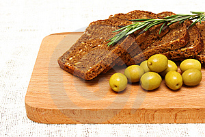 Bread, Olives, Rosemary And Wooden Board Royalty Free Stock Photos - Image: 13706998