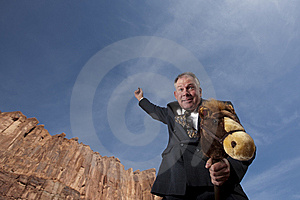 Businessman Riding A Stick Horse Royalty Free Stock Photos - Image: 13712488