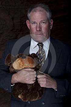 Businessman Clutching A Teddy Bear Stock Images - Image: 13713764
