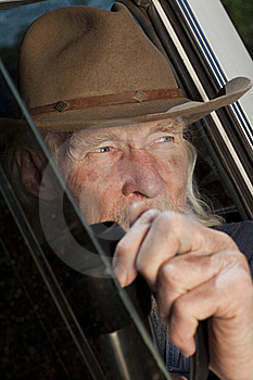 Senior Man With Cowboy Hat Sitting In Vehicle Royalty Free Stock Images - Image: 13714279