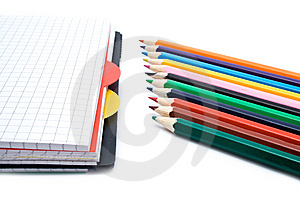 Notebook With A Spring And Pencils Stock Photos - Image: 13718083