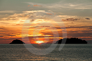 Sun Go Down Between Two Islands Royalty Free Stock Photos - Image: 13721398
