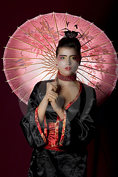 Sexy Young Geisha Holding A Painted Umbrella Royalty Free Stock Photo - Image: 13727695