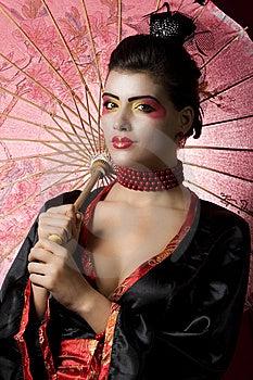 Young Geisha Looking At The Camera Stock Image - Image: 13727711