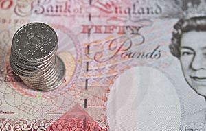 Five Pences Stacked On A Fifty Pound Note Stock Images - Image: 13730804