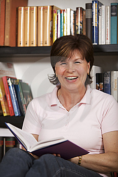 Senior Woman Laughing And Reading Stock Image - Image: 13731851