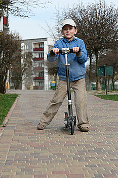 Kid And Scooter Royalty Free Stock Photos - Image: 13733548