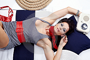 Pin-up Woman Laying And Listening Music Royalty Free Stock Photos - Image: 13734258