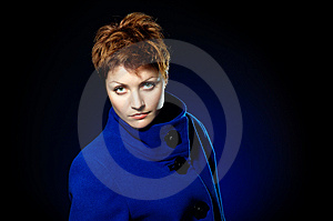 Lady  In A Blue Topcoat Royalty Free Stock Photography - Image: 13747017
