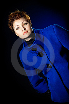 Lady  In A Blue Topcoat Royalty Free Stock Photo - Image: 13747035