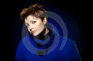 Lady  In A Blue Topcoat Royalty Free Stock Images - Image: 13747049