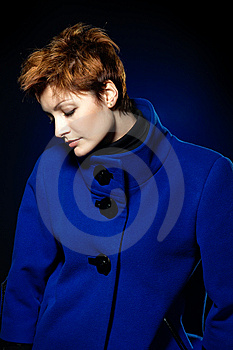 Lady  In A Blue Topcoat Royalty Free Stock Photography - Image: 13747077